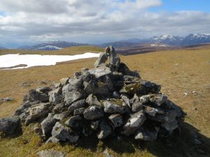 Pile of stones on top of a mountain